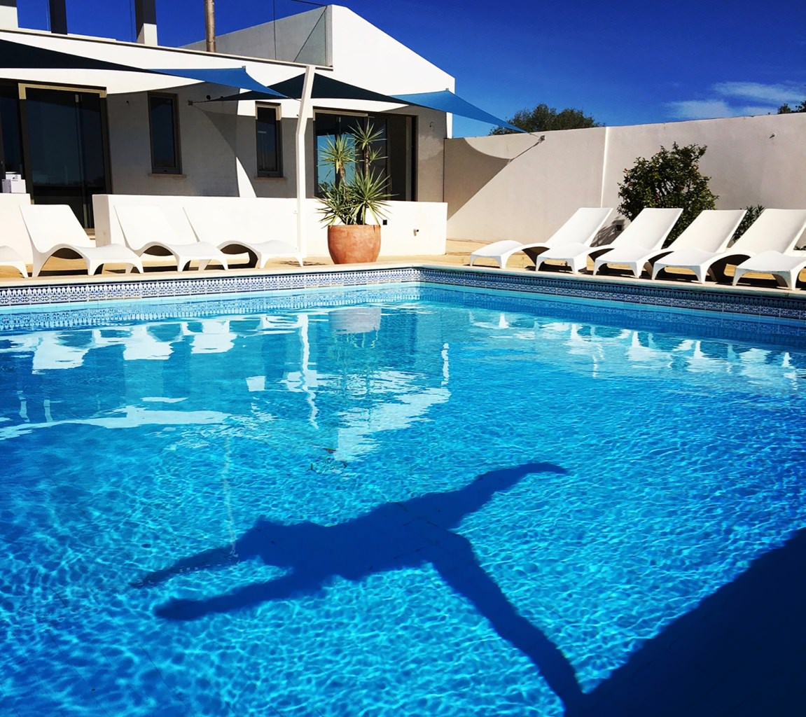 Alt Our hilltop oasis features an azure 40ft pool with sweeping panoramic views towards the coast.